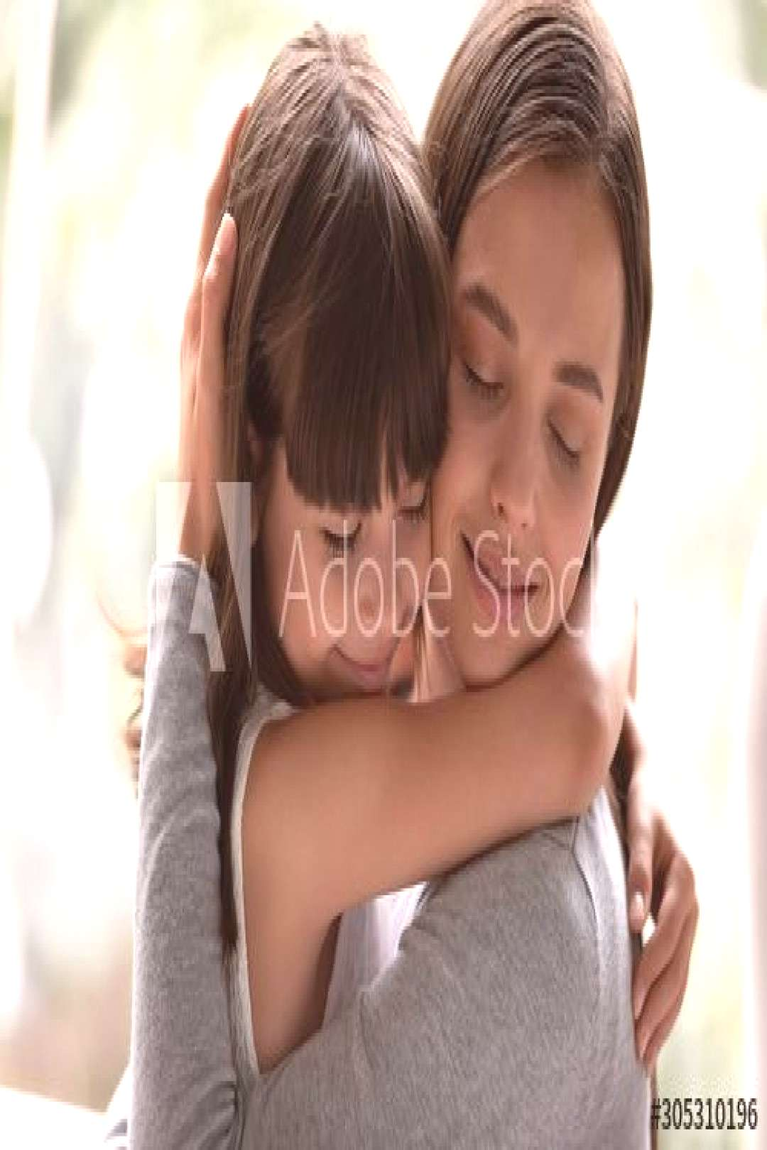 Mother and little daughter cuddling having strong bonds closeup view ,